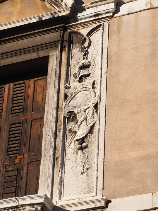 façade of Ca' Memmo, one window above the door is nicely embellished